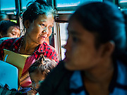 26 OCTOBER 2016 - NUPO TEMPORARY SHELTER, MAE CHAN, TAK, THAILAND: A woman being repatriated from the the Nupo Temporary Shelter refugee camp looks out the window of her bus before it leaves the camp. Sixtyfive Burmese refugees living in the Nupo Temporary Shelter refugee camp in Tak Province of Thailand were voluntarily repatriated to Myanmar. About 11,000 people live in the camp. The repatriation was the first large scale repatriation of Myanmar refugees living in Thailand. Government officials on both sides of the Thai / Myanmar border said the repatriation was made possible by recent democratic reforms in Myanmar. There are approximately 150,000 Burmese refugees living in camps along the Thai / Myanmar border. The Thai government has expressed interest several times in the last two years in starting the process of repatriating the refugees.     PHOTO BY JACK KURTZ