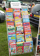 Car boot sale display of secondhand puzzle magazines, Suffolk, England, UK