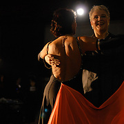 A female couple competes in the women's senior standard division of the same-sex ballroom dancing competition during the 2007 Eurogames at the Waagnatie hangar in Antwerp, Belgium on July 13, 2007. ..Over 3,000 LGBT athletes competed in 11 sports, including same-sex dance, during the 11th annual European gay sporting event. Same-sex ballroom is a growing sports that has been happening in Europe for over two decades.