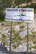 Sign for The Accursed Mountains, Prokletije, Bjeshkët e Namuna, which have been rebranded as  Blessed Mountains Bjeshket e Bekura  Valbona, Albania. 05Sep15