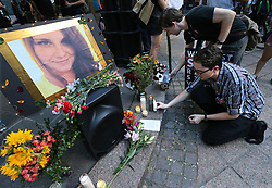 August 13, 2017 - Atlanta, Georgia, U.S. - STEPHEN FRIEDRICH, front, and SCOTT DOUGLAS set out candles for Heather Heyer as hundreds gather for an anti-white nationalism memorial and march in response to violence in Virginia at Woodruff Park on Sunday. (Credit Image: © Curtis Compton/TNS via ZUMA Wire)