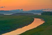 Sunset light over creek<br />Kamouraska<br />Quebec<br />Canada