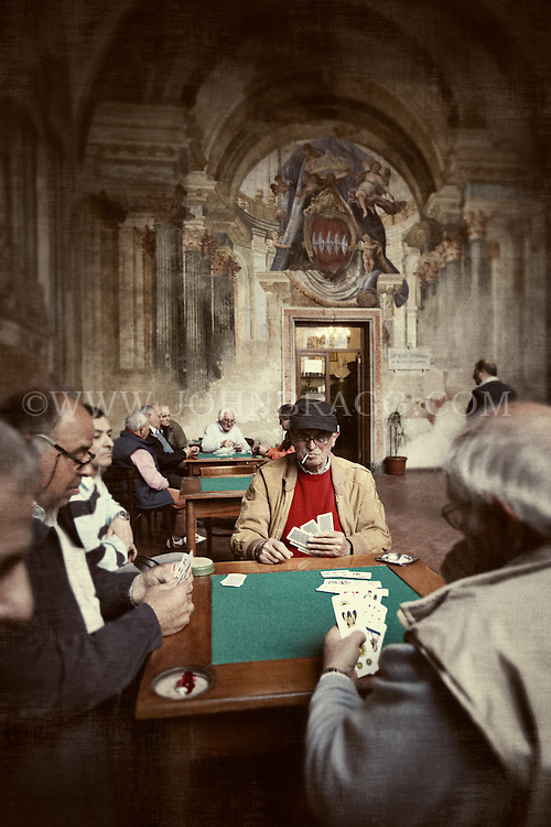 Elderly men playing cards at The Men's Club in Sorrento, Italy.