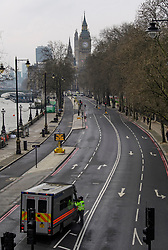 © Licensed to London News Pictures. 23/03/2017. London, UK. Embankment deserted of traffic, leading to The Houses of Parliament, the day after a lone terrorist killed 4 people and injured several more, in an attack using a car and a knife. The attacker managed to gain entry to the grounds of the Houses of Parliament, killing one police officer. Photo credit: Ben Cawthra/LNP