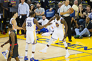 Golden State Warriors forward Kevin Durant (35) and forward Draymond Green (23) celebrate after blocking a shot on Atlanta Hawks guard Dennis Schroder (17) at Oracle Arena in Oakland, Calif., on November 28, 2016. (Stan Olszewski/Special to S.F. Examiner)