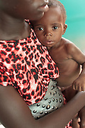 Chacklie Soman, 17, holds her son Leo Karsor, 8 months, who is malnourished, during growth monitoring at the Pipeline health center in Monrovia, Montserrado county, Liberia on Monday April 2, 2012.