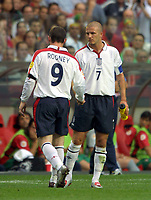 Wayne Rooney (England) David Beckham consoles him as he is forced to leave the field for his injured foot. England v Portugal. Euro Championships 2004. 24/6/04. Credit : Colorsport/Andrew Cowie.