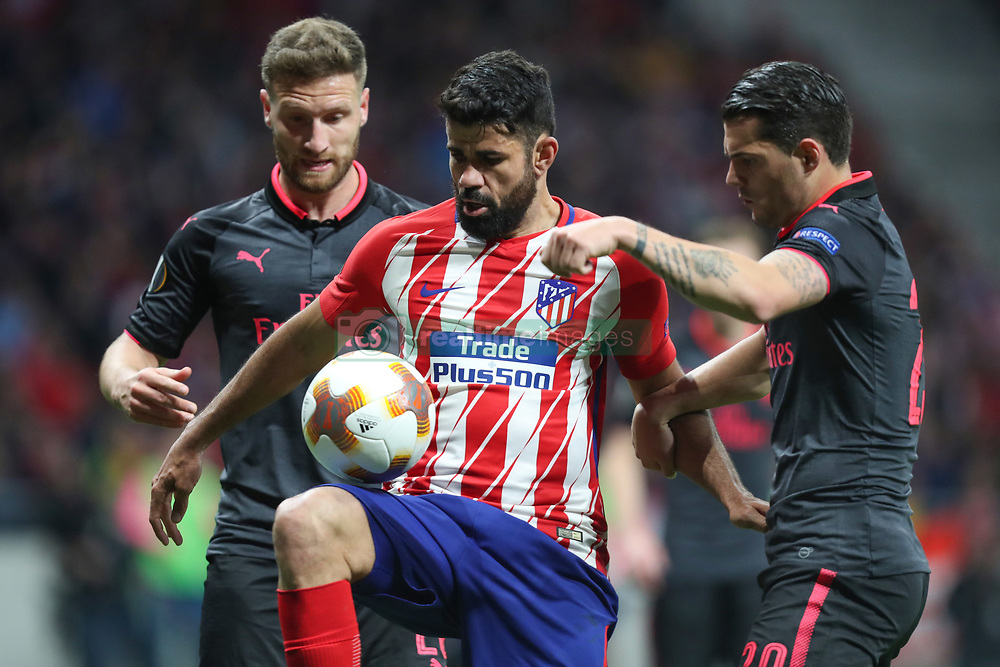 May 3, 2018 - Madrid, Spain - DIEGO COSTA of Atletico de Madrid duels for the ball with GRANIT XHAKA of Arsenal FC during the UEFA Europa League, semi final, 2nd leg football match between Atletico de Madrid and Arsenal FC on May 3, 2018 at Metropolitano stadium in Madrid, Spain (Credit Image: © Manuel Blondeau via ZUMA Wire)