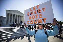 October 3, 2017 - Washington, District of Columbia, U.S. - JANICE FORD, of Maryland, protests outside the United States Supreme Court as the court hears oral arguments in Gill v. Whitford a case about Gerrymandering in Wisconsin. (Credit Image: © Alex Edelman via ZUMA Wire)