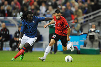 FOOTBALL - UEFA EURO 2012 - QUALIFYING - GROUP STAGE - GROUP D - FRANCE v ALBANIA - 07/10/2011 - PHOTO GUY JEFFROY / DPPI - KLODIAN DURO (ALB) / BAFETIMBI GOMIS (FRA)