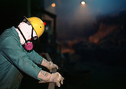 29 JANUARY 1999  - EL PASO, TEXAS: A worker at the Asarco copper smelter in El Paso, Texas, rests during his shift. Asarco mothballed the smelter for at least three years because of low prices in the copper industry. In mid 1997, copper was selling for approximately $1.20 per pound, it is currently selling for about .65 cents per pound, forcing copper producers like Asarco to take drastic belt tightening measures. About 370 workers were laid off as the plant's machinery was mothballed. Closure of the Asarco smelter comes on the heels of the closure of copper mines in southern New Mexico owned by the Phelps-Dodge company, an Asarco competitor. Asarco officials have said they may reopen the plant if copper prices rebound. Photo by Jack Kurtz / ZUMA Press