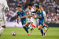 Real Madrid's player Marco Asensio and Celta de Vigo's player Pablo Hernandez and Hugo Mallo during a match of La Liga Santander at Santiago Bernabeu Stadium in Madrid. August 27, Spain. 2016. (ALTERPHOTOS/BorjaB.Hojas)