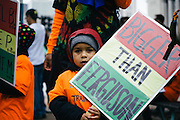A child holds a sign before a march in downtown St. Louis on October 11th, 2014.