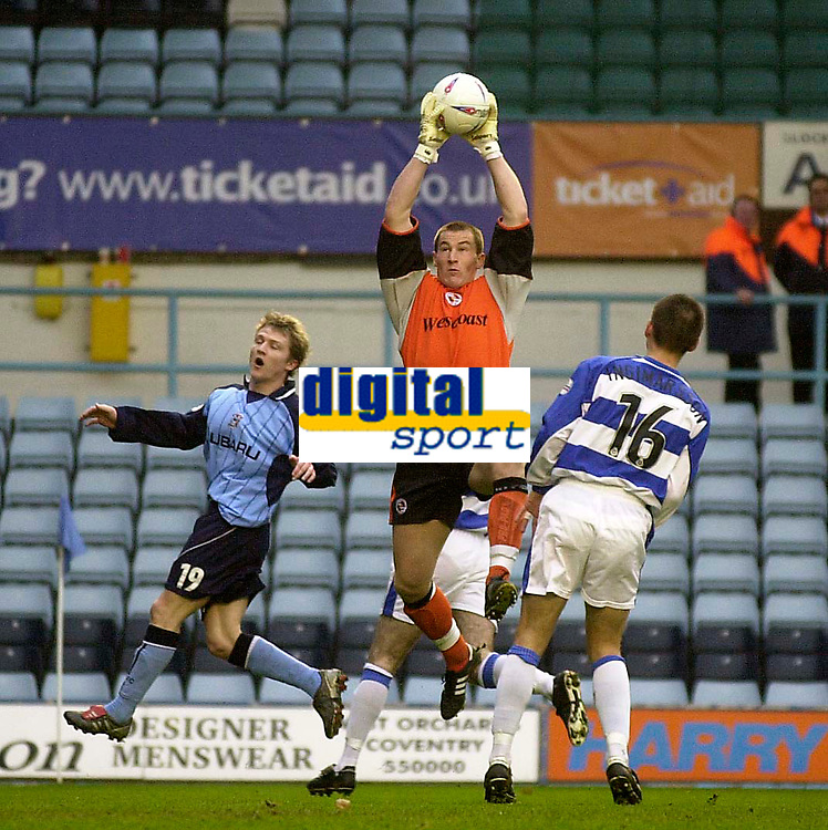 Photo. Glyn Thomas.<br /> Coventry City v Reading. Nationwide Division 1.<br /> Highfield Road, Coventry. 27/03/2004.<br /> Reading's keeper Jamie Ashdown (C) leaps high to make a save under pressure from Coventry's Gary McSheffrey (L) as Ivar Ingimarsson (R) looks on.