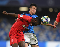 NAPLES, Nov. 6, 2019  Napoli's Hirving Lozano (rear) vies with Salzsburg's Jerome Onguene during the UEFA Champions League Group E match between Napoli  and Salzsburg in Naples, Italy, Nov. 5, 2019. (Photo by Alberto Lingria/Xinhua) (Credit Image: © Cheng Tingting/Xinhua via ZUMA Wire)