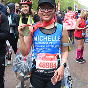 London, England, UK. 28 April 2019. Xiao Mo Xu from China finish the Virgin Money London Marathon at Pall Mall.