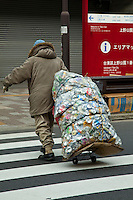 Homeless Japanese Man Recycling Aluminum Cans