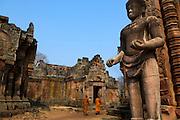 Two monks explore the Khmer ruins of Prasat Phanom Rung.