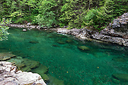 Emerald green pools in Gold Creek in Golden Ears Park near Maple Ridge, British Columbia, Canada.  The colour here is from minerals suspended in Gold Creek's water from its journey down from the Coast Mountains.