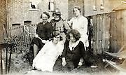 female group having fun in backyard England
