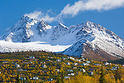 Alaska. Anchorage. Developement of new homes and housing in the Prospect heights area of Anchorage. Homes growing up the side of the Chugach Mountains in fall color. O'Malley Peak.