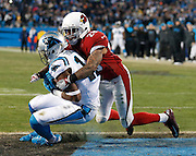 CHARLOTTE, NC - JAN 24:  Wide receiver Devin Funchess #17 of the Carolina Panthers makes a touchdown reception in front of safety Rashad Johnson #26 of the Arizona Cardinals during the NFC Championship game at Bank of America Stadium on January 24, 2016 in Charlotte, North Carolina.