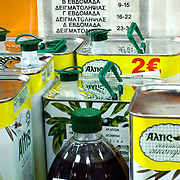 tins and bottles of processed olive oil for testing at the plants' laboratory