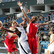 Efes Pilsen's Erwin DUDLEY (L) and Erdemir's James Dilliard THOMAS (R) during their Turkish Basketball league match Efes Pilsen between Erdemir at the Sinan Erdem  Arena in Istanbul Turkey on Saturday 29 January 2011. Photo by TURKPIX