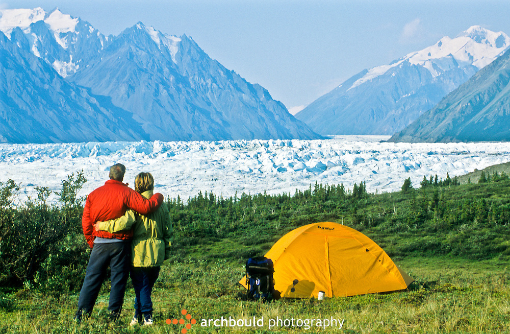 Hikers look at Donjek Glacier in Kluane National Park  from their campsite.