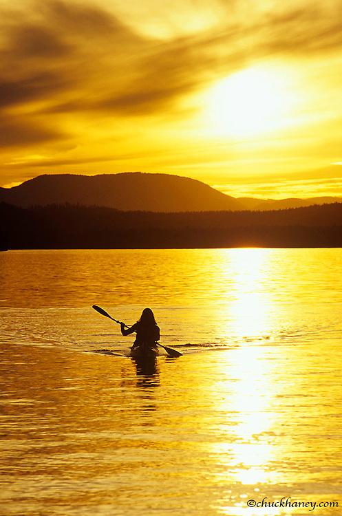 Sea Kayaking on Whitefish Lake at Sunset in Montana<br /> model released