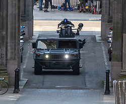 26JUL21 A Batman body double drives the Batcycle through the street's of Glasgow as filming of The Flash got underway on Monday.