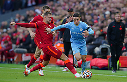 Liverpool's Jordan Henderson (left) and Manchester City's Phil Foden battle for the ball during the Premier League match at Anfield, Liverpool. Picture date: Sunday October 3, 2021.
