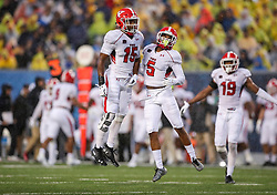 Sep 8, 2018; Morgantown, WV, USA; Youngstown State Penguins cornerback Avery Larkin (15) and Youngstown State Penguins cornerback William Latham (5) celebrate after a defensive play during the second quarter against the West Virginia Mountaineers at Mountaineer Field at Milan Puskar Stadium. Mandatory Credit: Ben Queen-USA TODAY Sports