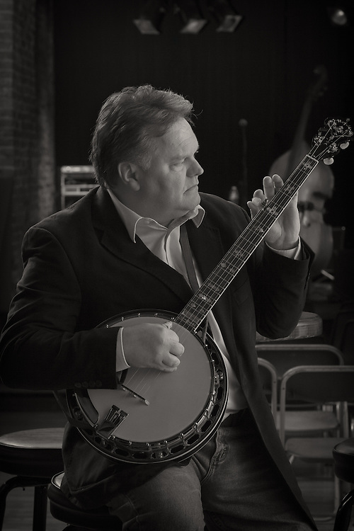 Murrell Thixton of Storefront Congregation tuning up before a show at Uncle Slayton's in Louisville, Kentucky.