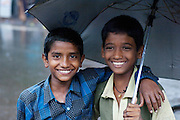 Children shelter from the monsoon rains, Cochin, India.