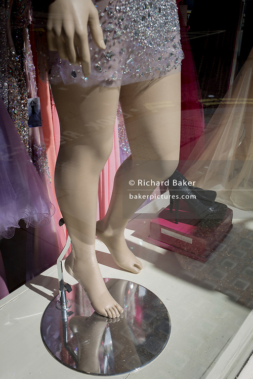 A detail of a shop mannequins feet and legs in the window of a business, on 18th April 2017, in London, England.