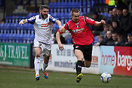 Oldham Athletic's David Mellor breaks away from Tranmere Rovers' Ryan Lowe. Skybet football league 1match, Tranmere Rovers v Oldham Athletic at Prenton Park in Birkenhead, England on Saturday 1st March 2014.<br /> pic by Chris Stading, Andrew Orchard sports photography.