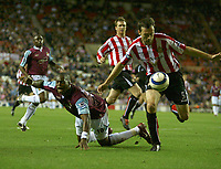 Photo: Andrew Unwin.<br /> Sunderland v West Ham United. The Barclays Premiership.<br /> 01/10/2005.<br /> West Ham's Marlon Harewood (L) falls under pressure from Sunderland's Gary Breen (R) but no penalty is given.