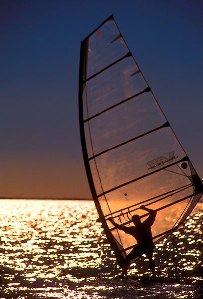 Silhouette of Man Windsurfing in South Padre, Texas