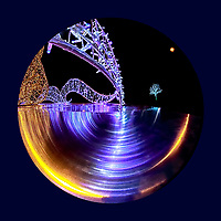 Surrealistic Lumiere:  This selective photo is of the distorted reflection of light from a light installation, with an additional distant tree installation in the background, at the Lumiere celebration, Vancouver British Columbia Canada.