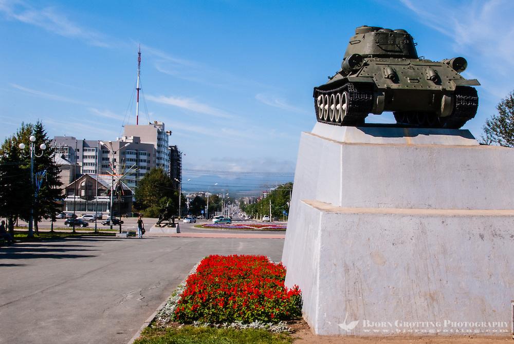 Russia, Sakhalin, Yuzhno-Sakhalinsk. An old Soviet era tank serves as a monument.