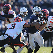 Yale running back Tyler Varga bursts through the Princeton defensive line to score a touchdown during the Yale Vs Princeton, Ivy League College Football match at Yale Bowl, New Haven, Connecticut, USA. 15th November 2014. Photo Tim Clayton