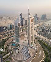 Aerial view of the Emirates Towers in misty Dubai, U.A.E.