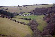 Rural farm housing in valley near Combe Martin, Devon, England