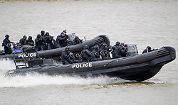 © Licensed to London News Pictures. 19/03/2017. London, UK. Anti-terror Police intercept a tourist boat, taken hostage by people playing armed terrorists, in an ant-terror training exercise takes place on The River Thames in  London. It is the first time that an exercise of this type has taken place on the river. Photo credit: Ben Cawthra/LNP