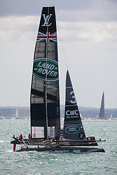 © Licensed to London News Pictures. 25/07/2015. Portsmouth, UK. Team Land Rover BAR (Ben Ainslie Racing) finishing race one in first place in the first leg of the America's Cup World Series in Portsmouth this weekend. Today, 25th July 2015, is the first race day in which British Olympic sailing legend, Sir Ben Ainslie, will be leading his all-British team, Land Rover BAR, against other teams in a battle to qualify for a place in the two team America's Cup final, to be held in Bermuda in 2017.  Photo credit : Rob Arnold/LNP