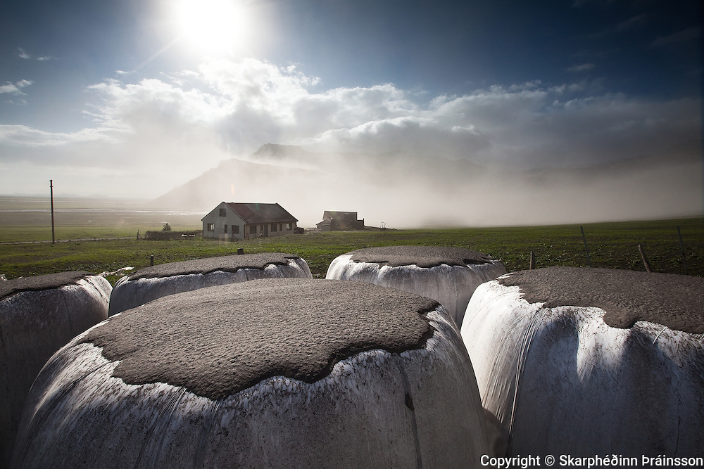 Ash coated fields of south Iceland, while erupting volcano in Eyjafjallajökull