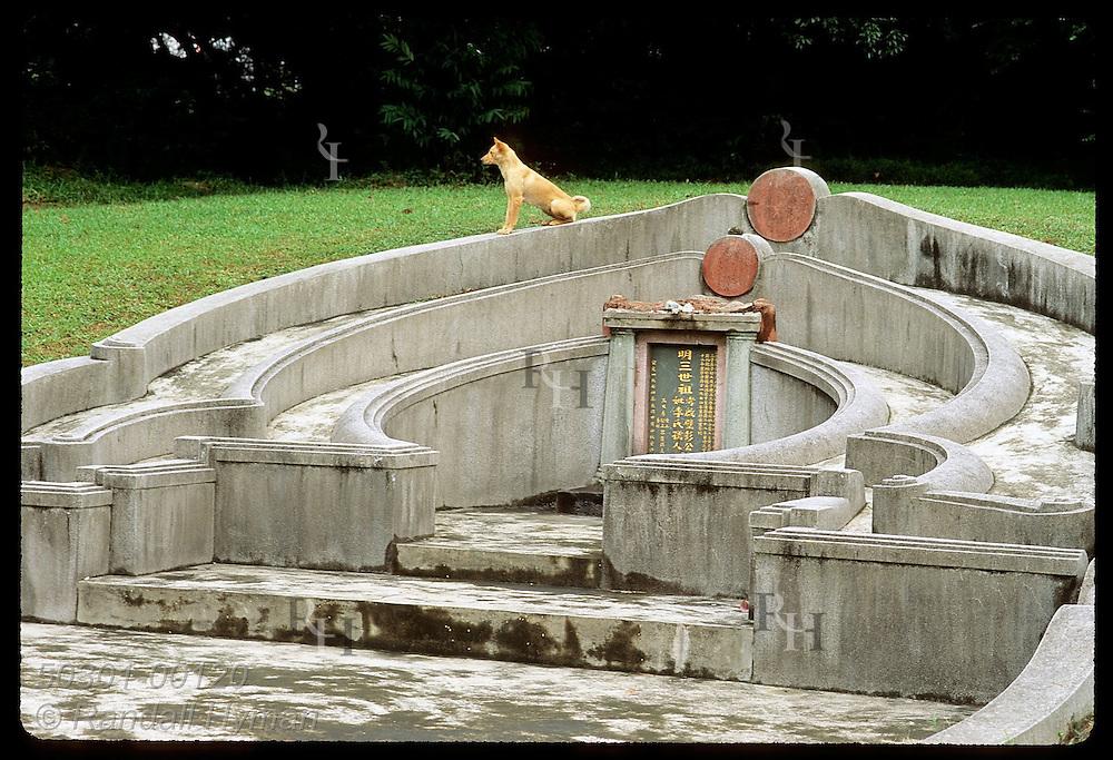 Dog is at home amid lavish memorial long ago chosen as auspicious site for rich man's grave; N.T. Hong Kong