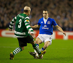 LIVERPOOL, ENGLAND - Tuesday, February 16, 2010: Everton's Leon Osman and Sporting Clube de Portugal's Daniel Carrico during the UEFA Europa League Round of 32 1st Leg match at Goodison Park. (Photo by: David Rawcliffe/Propaganda)