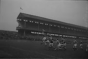 21/02/1965<br /> 02/21/1965<br /> 21 February 1965<br /> Munster v Ulster Railway Cup semi-final at Croke Park. The final score was Ulster 0-14 Munster 0-9. <br /> Munster's P. McMahon jumps high to gain possession of the ball.